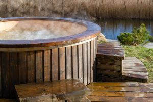 How,Water,Swirling,In,Wooden,Hot,Tub,Outside,In,Nature.